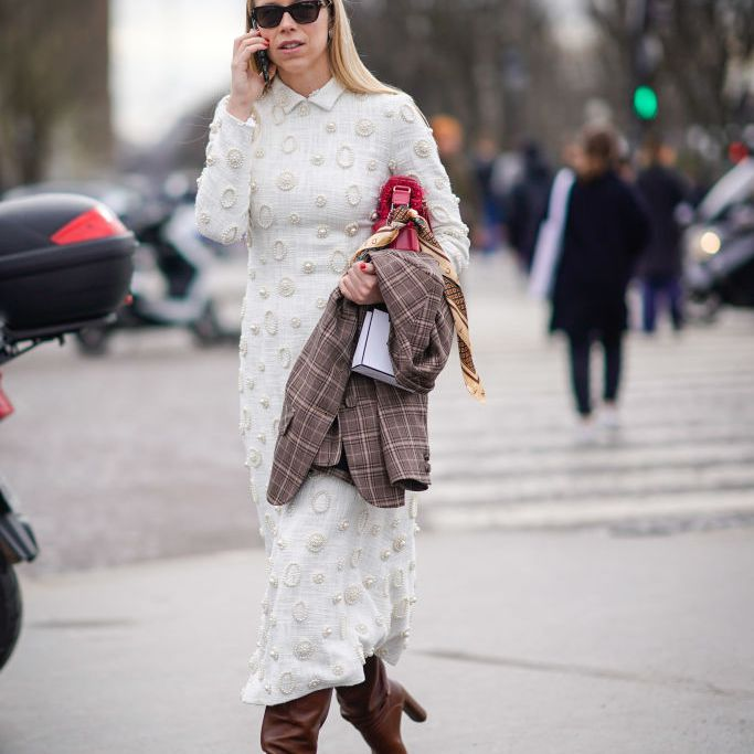 Street style fashion woman in dress and slouchy boots
