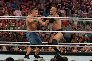 The Rock and John Cena performing in a wrestling match