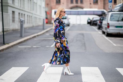 Street style woman wearing short white boots with a long sleeved dress