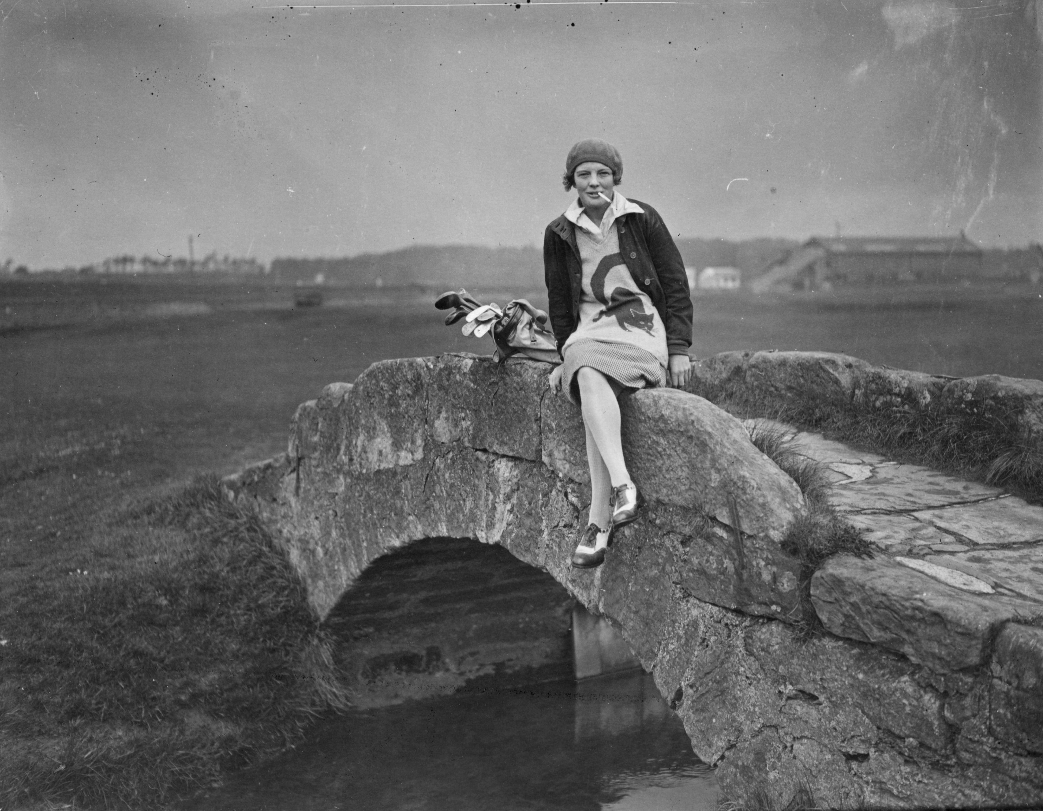 Competitor Miss Margaret Hamilton sitting on Swilcan Bridge at St Andrews golf course during the Ladies' British Open Amateur Championship in 1929