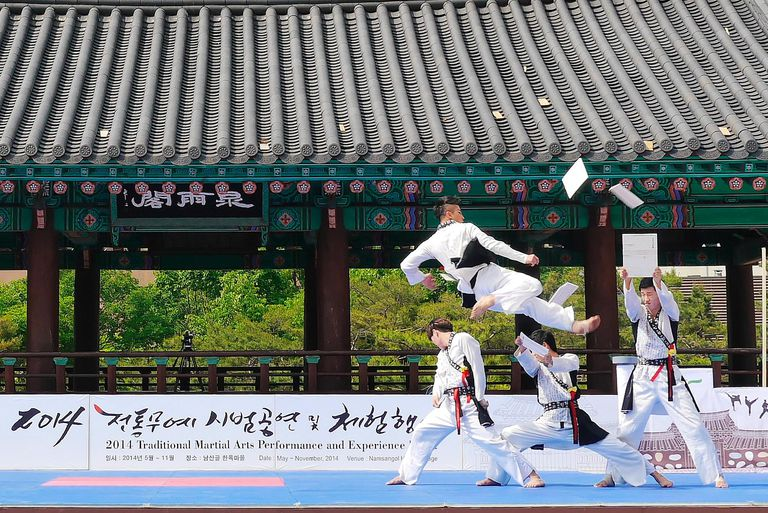 People practicing martial arts