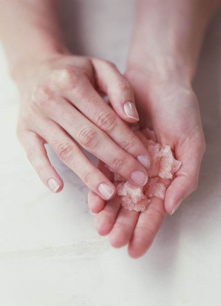 A person with an exfoliating scrub in their hands