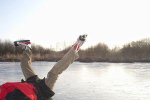 Fallen ice skater on ice