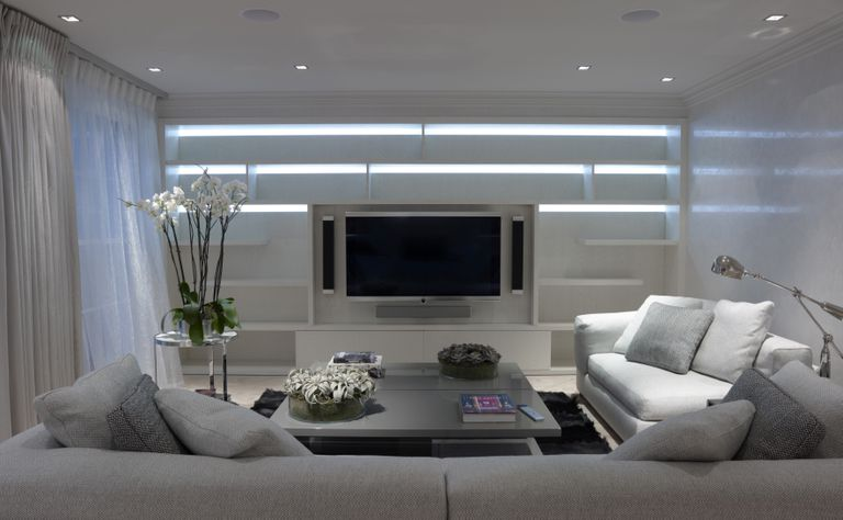 Grey sitting room with two sofas, coffee table and flat screen TV, residential house, Lyall Mews, Belgravia, London, UK