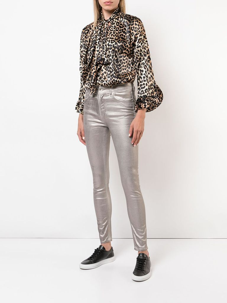 7babfc7f26 Creative Office Party Outfit. Woman in leopard print blouse and gold jeans