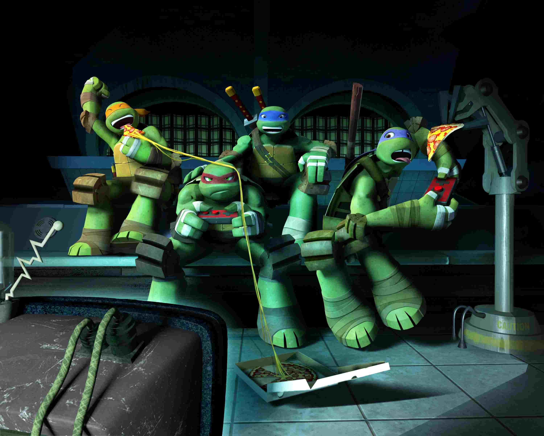 The 'Teenage Mutant Ninja Turtles' eating pizza while watching tv.