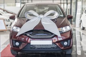 New car with bow in showroom
