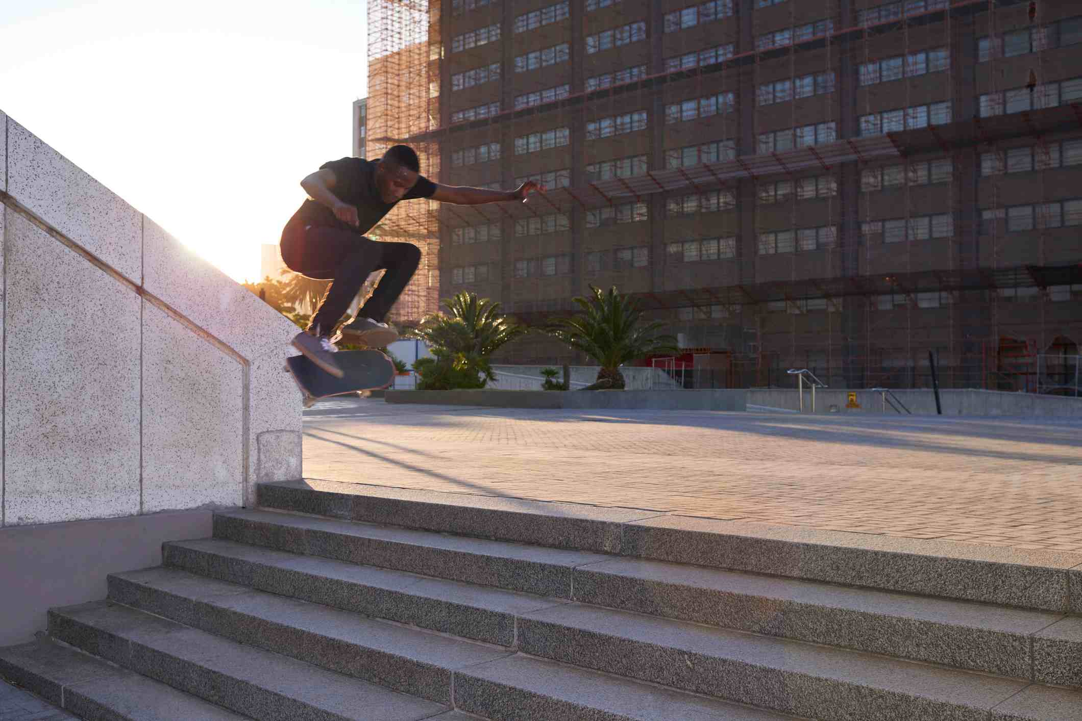 Shot of a young skater skating down a flight of stairs
