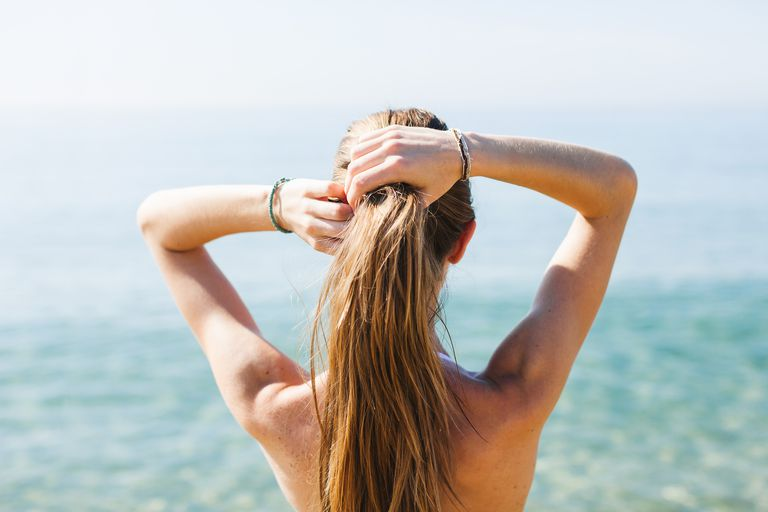Woman with ponytail at the beach