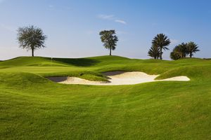 General view of a golf course bunker and green