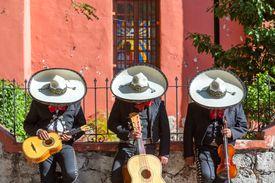 Mexican Mariachi group doing a siesta, Mexico