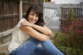 Woman outdoors in jeans smiling