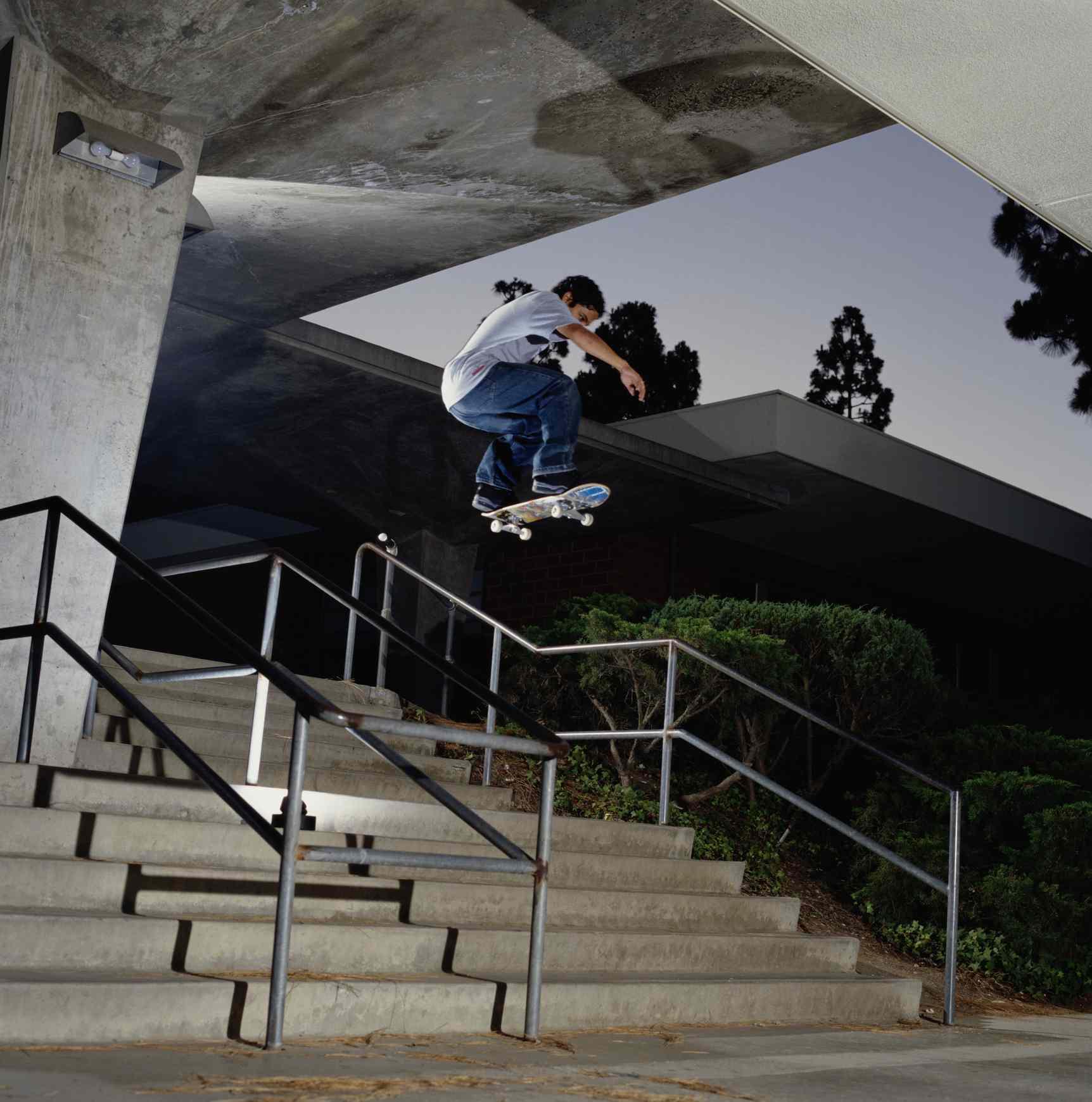 Skateboarder jumping stairway, mid air