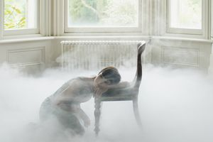 Woman in foggy living room