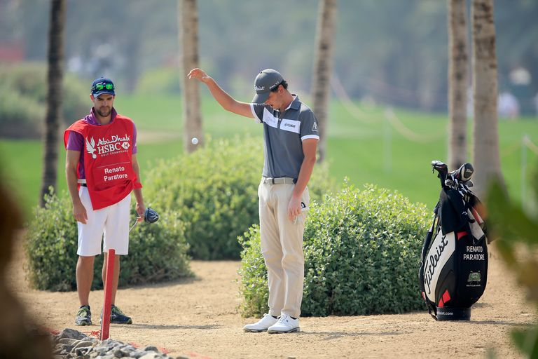 Renato Paratore of Italy takes a penalty drop during the 2016 Abu Dhabi HSBC Championship