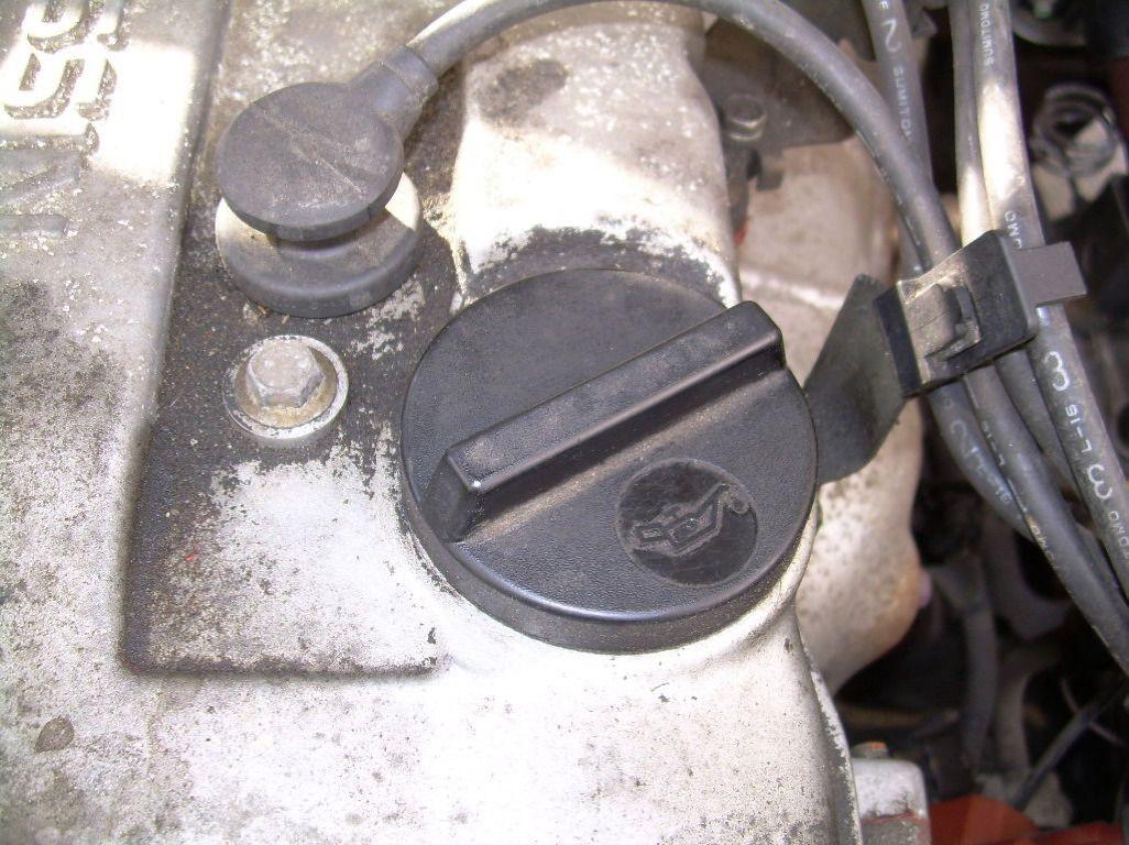 Remove the oil cap.