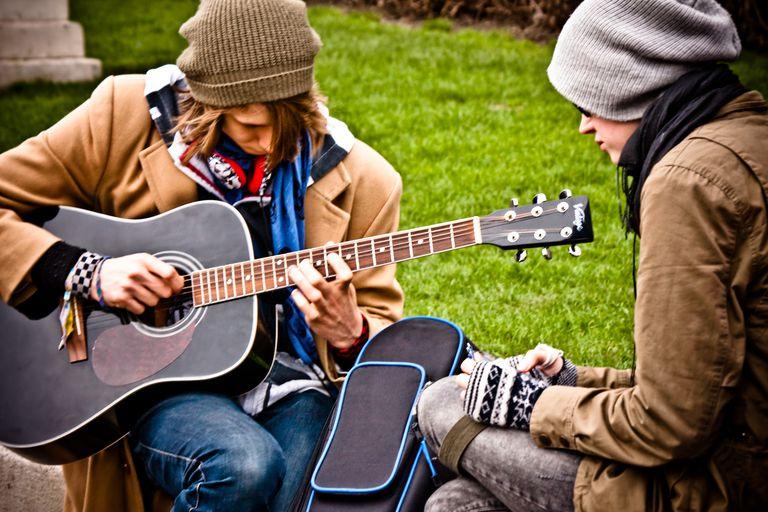 Strumming a guitar