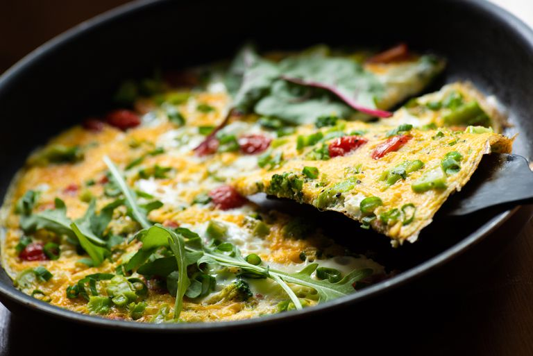 Italian frittata with tomatoes, herbs and cheese