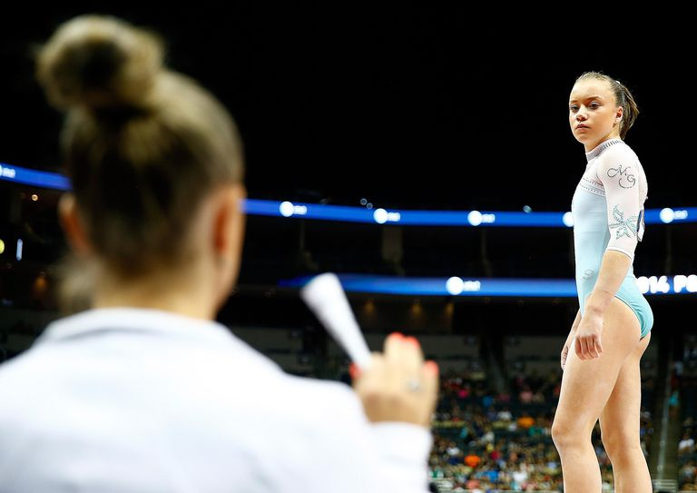 Jazmyn Foberg, a gymnast competing at the 2014 US Gymnastics Nationals, looks over at a teammate