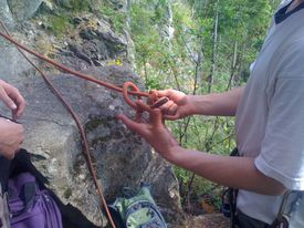 Man tying a knot