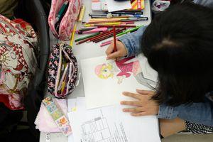 woman drawing an anime comic