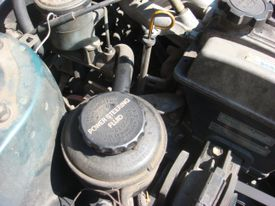 The power steering fluid reservoir should be clearly labeled to check the level.