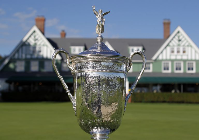 The US Open trophy with the Oakmont Country Club clubhouse in the background.