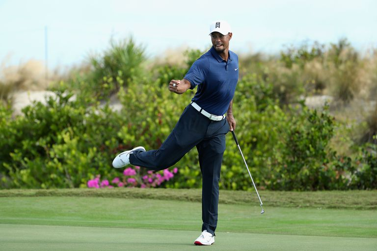 Tiger Woods celebrates a birdie putt at the 2016 Hero World Challenge