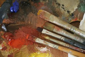 Paint brush with oil paint on a classical palette