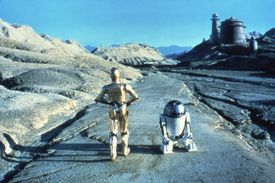 Anthony Daniels as C-3PO and Kenny Baker as R2-D2 in a scene from the 1983 film 'Return of the Jedi'