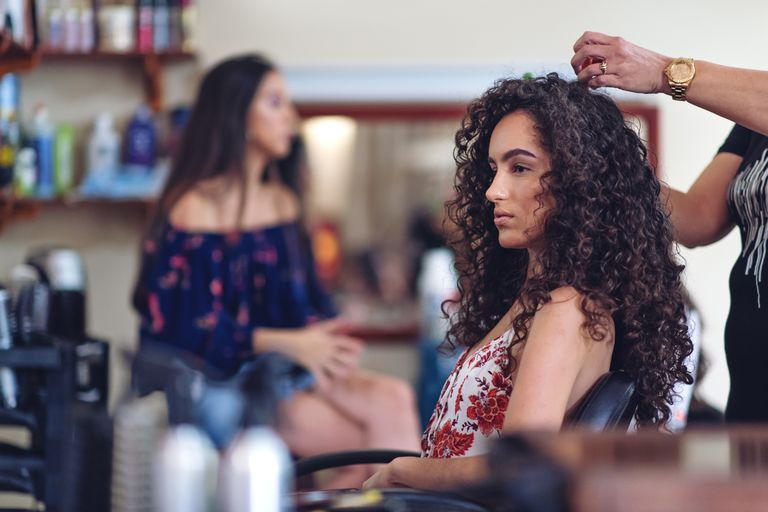 Woman with curly hair at hair salon