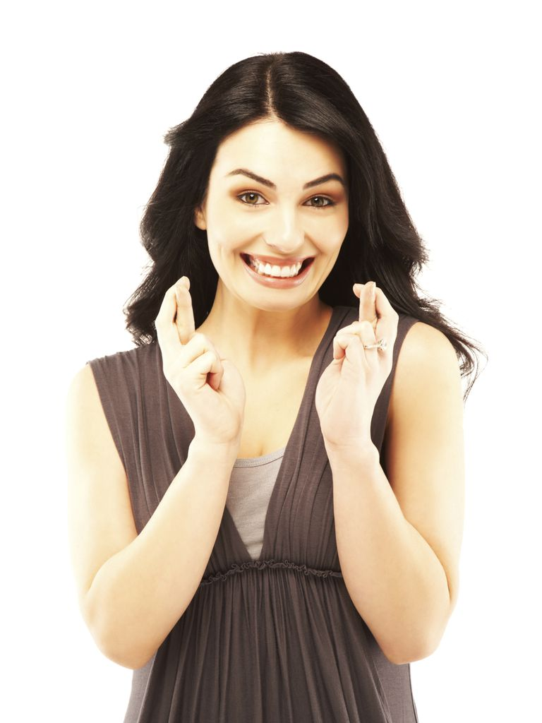 Image of a woman crossing her fingers for luck.
