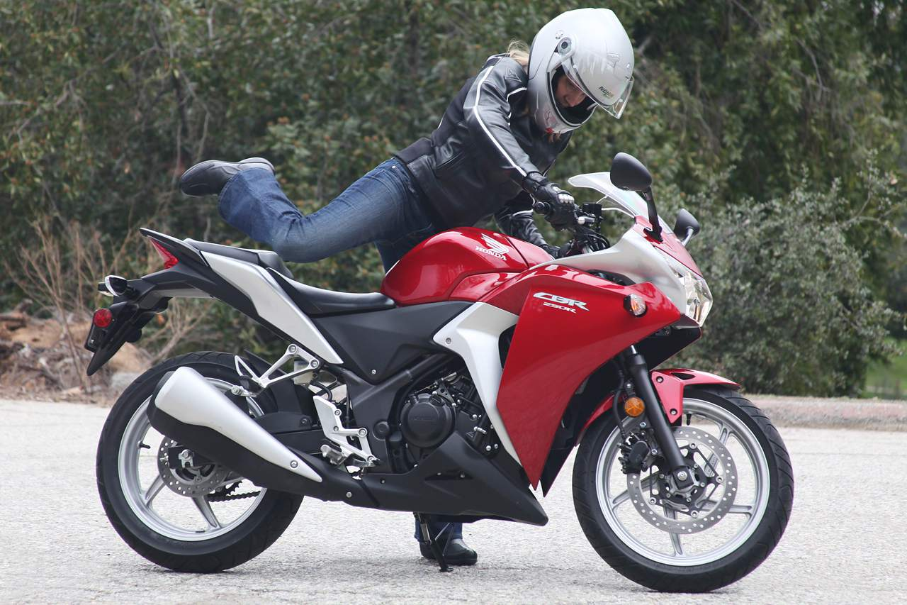 Woman stepping onto a motorcycle