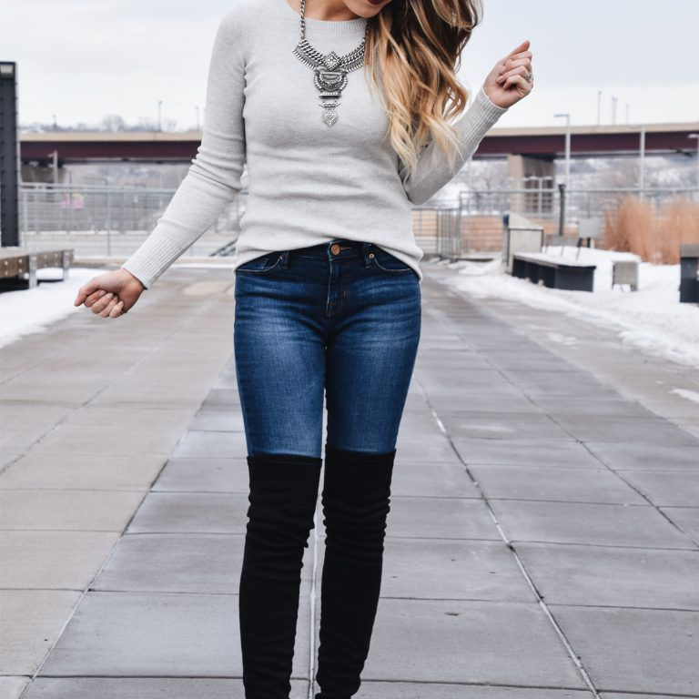 Woman in jeans and thigh high boots