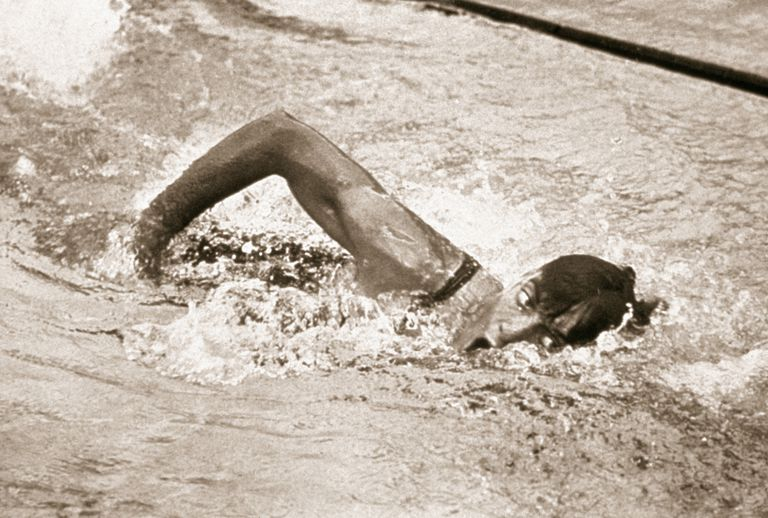 American swimmer Johnny Weissmuller takes a breath while swimming freestyle