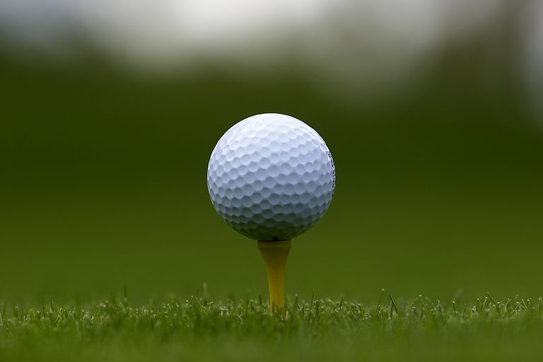 Close-up of a golf ball on a tee