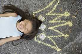 girl with sidewalk chalk crown overhead