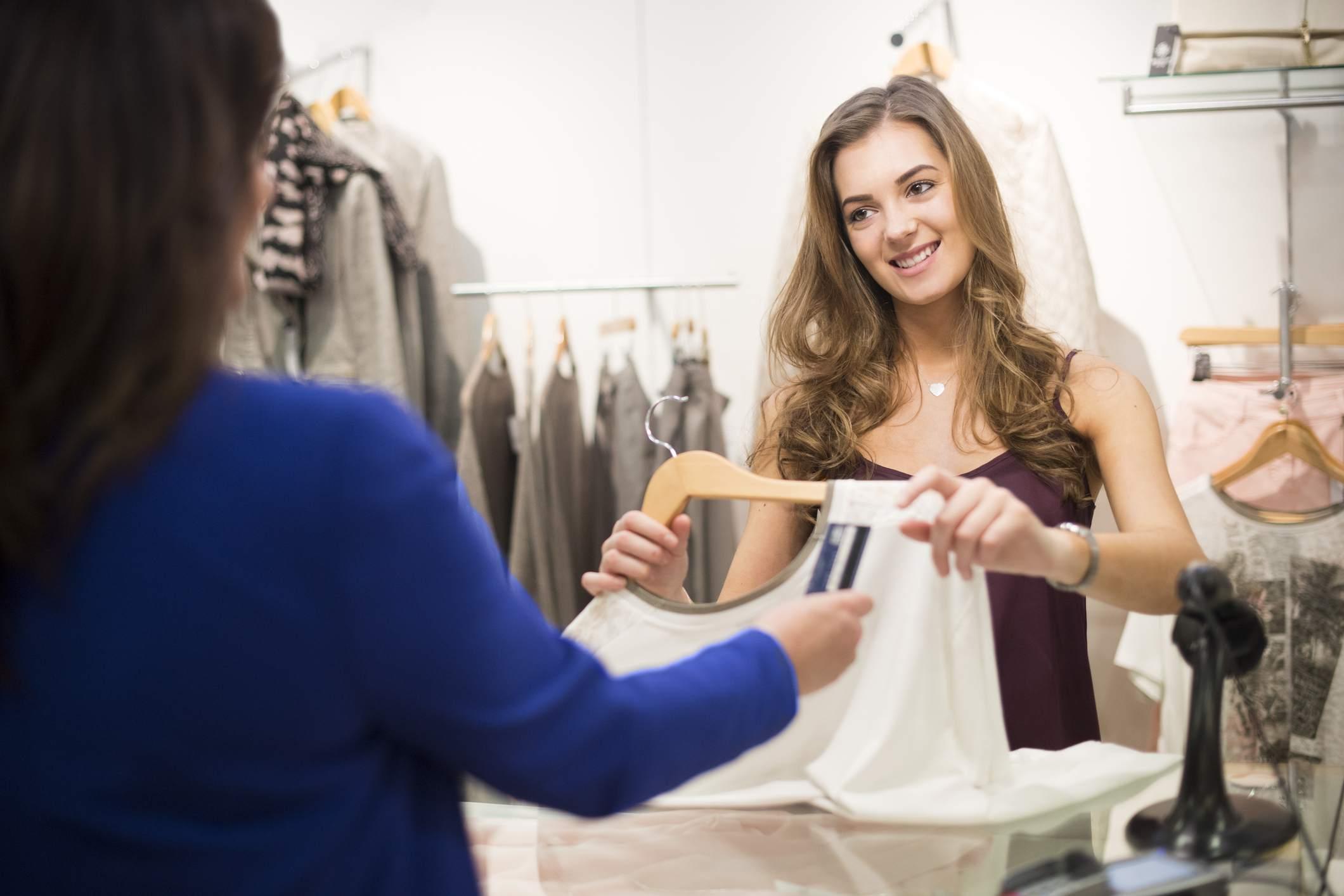 young sales assistnat smiling to customer