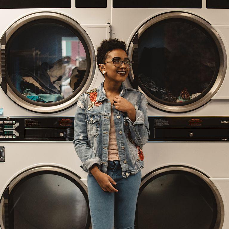black femme at the laundromat