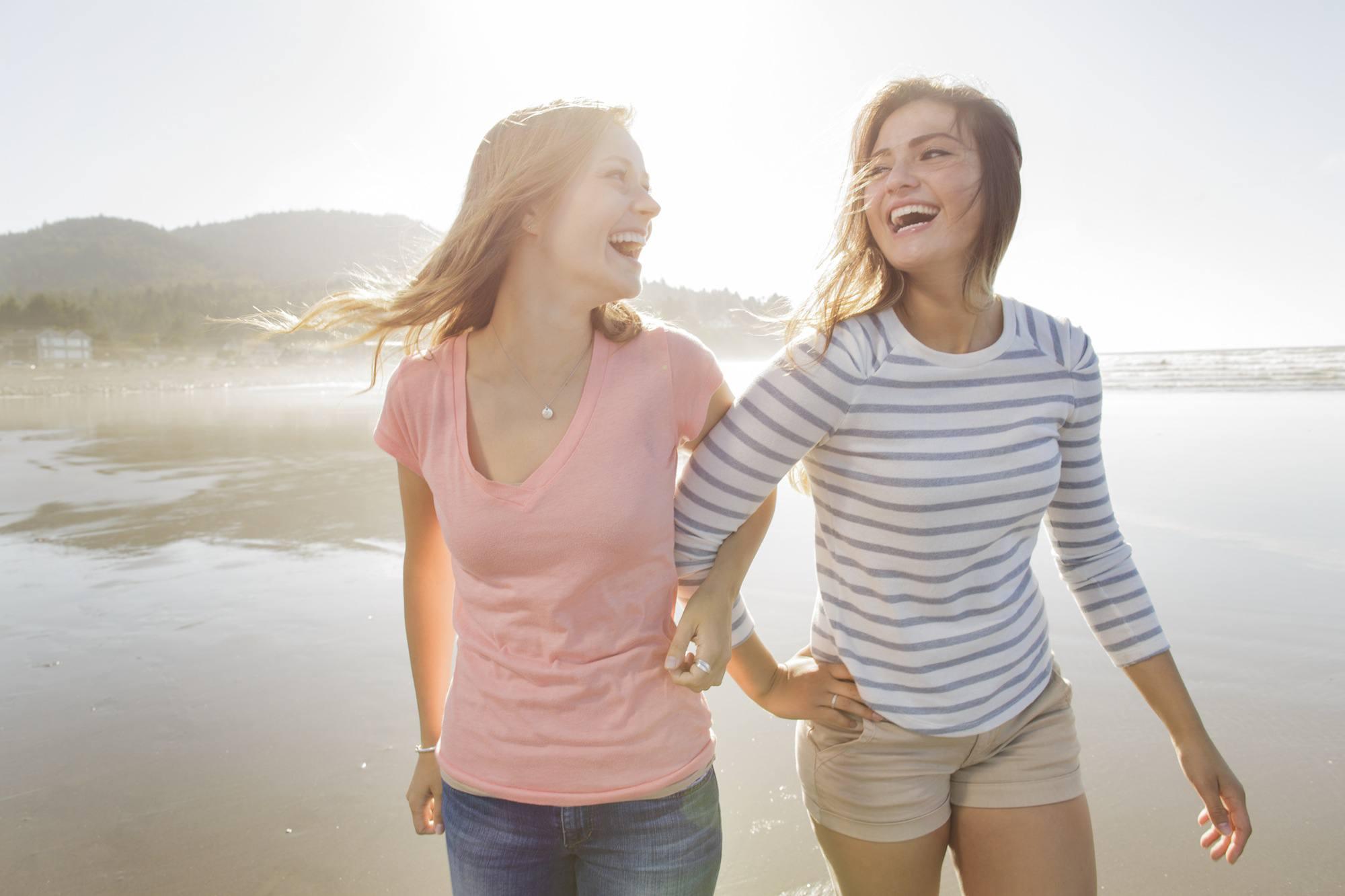 Young Woman Having Fun Walking on the beach