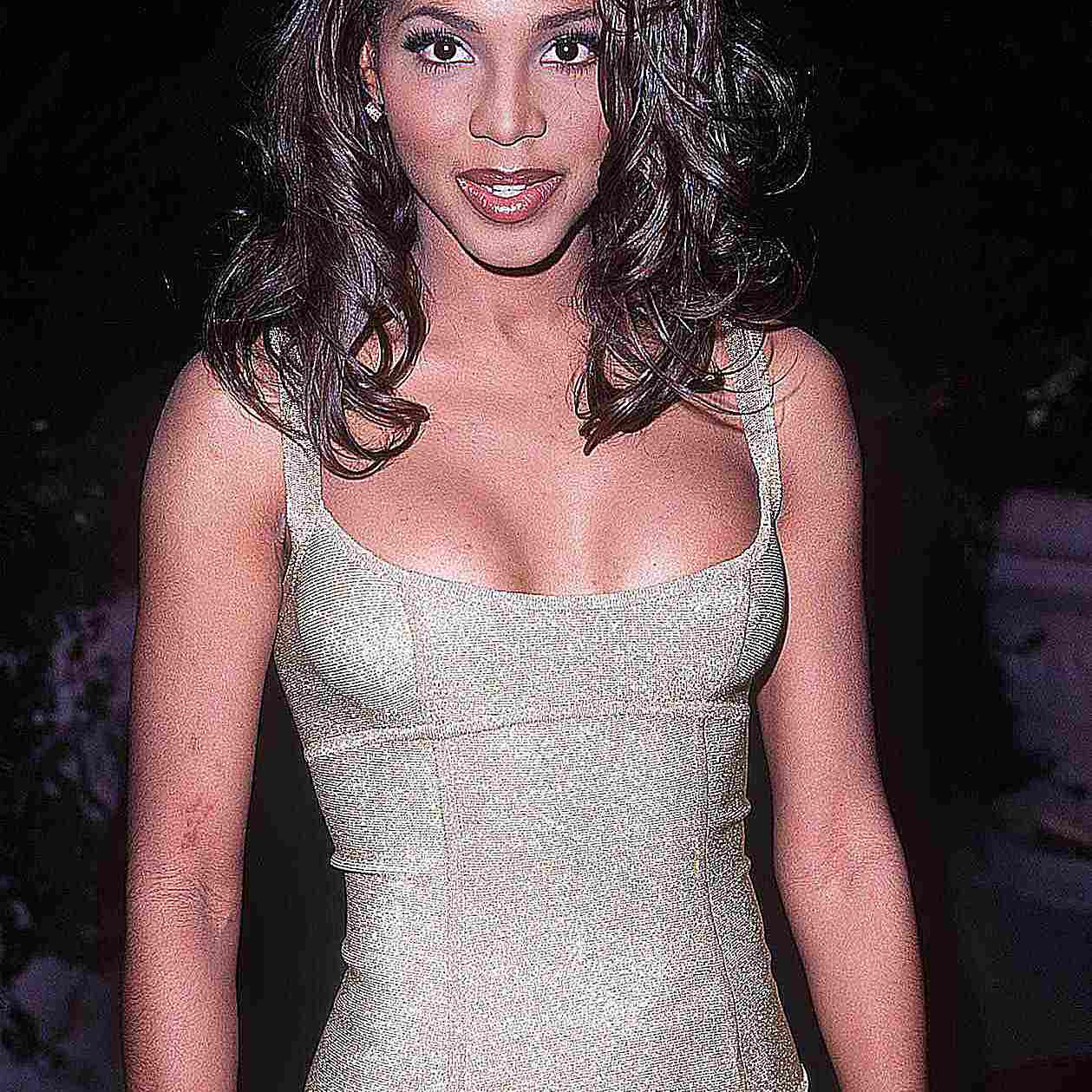 Toni Braxton in a grey dress