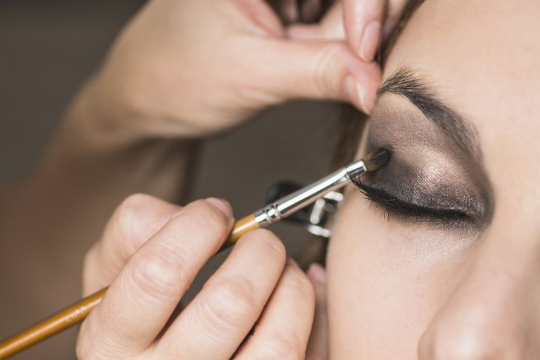 Make-up artist applying smoky eye