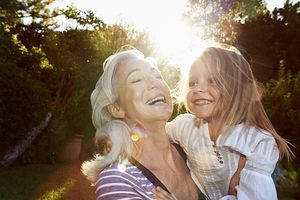 French Canadian Grandmother Laughing With Granddaughter