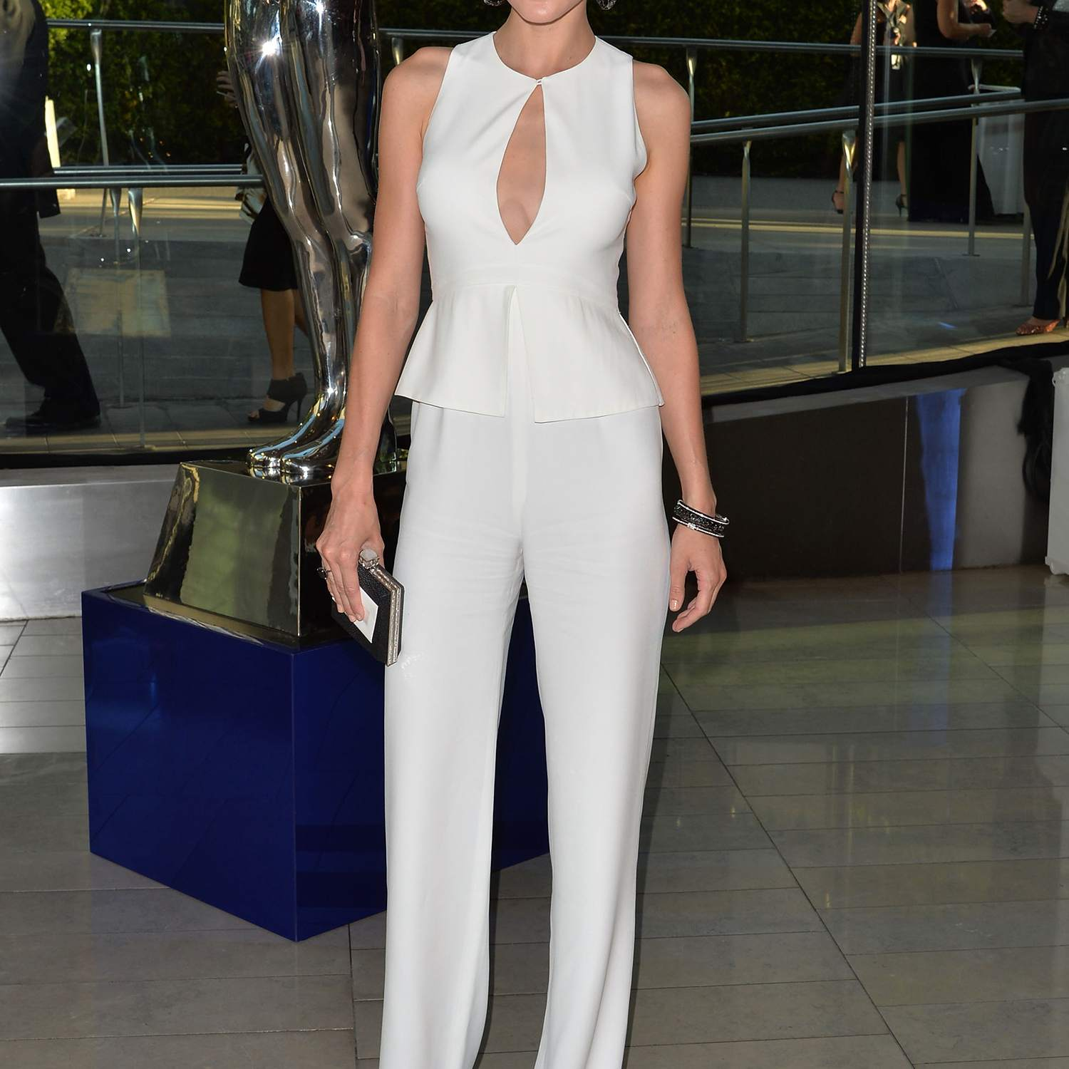 295adcaba8 Jessica Stam, in white jumpsuit and dark sandals, attending the 2014 CFDA  fashion awards