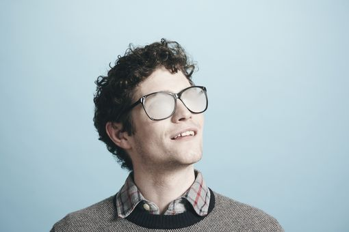 Man wearing foggy glasses