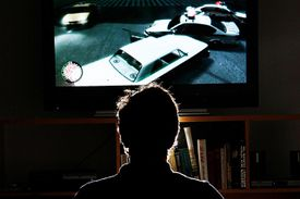 A gamer playing Grand Theft Auto IV