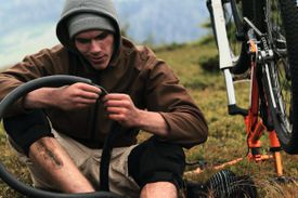 A man repairing a bicycle