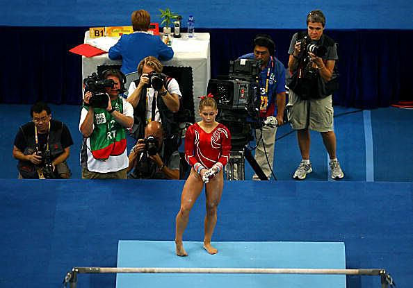 Gymnast Shawn Johnson prepares to go on bars at the 2008 Olympic gymnastics competition