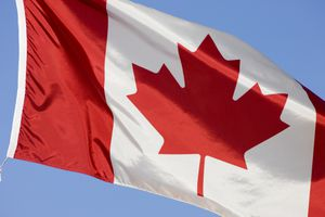 Photo of a Canadian flag against a blue sky, illustrating About.com's Canadian Sweepstakes List.
