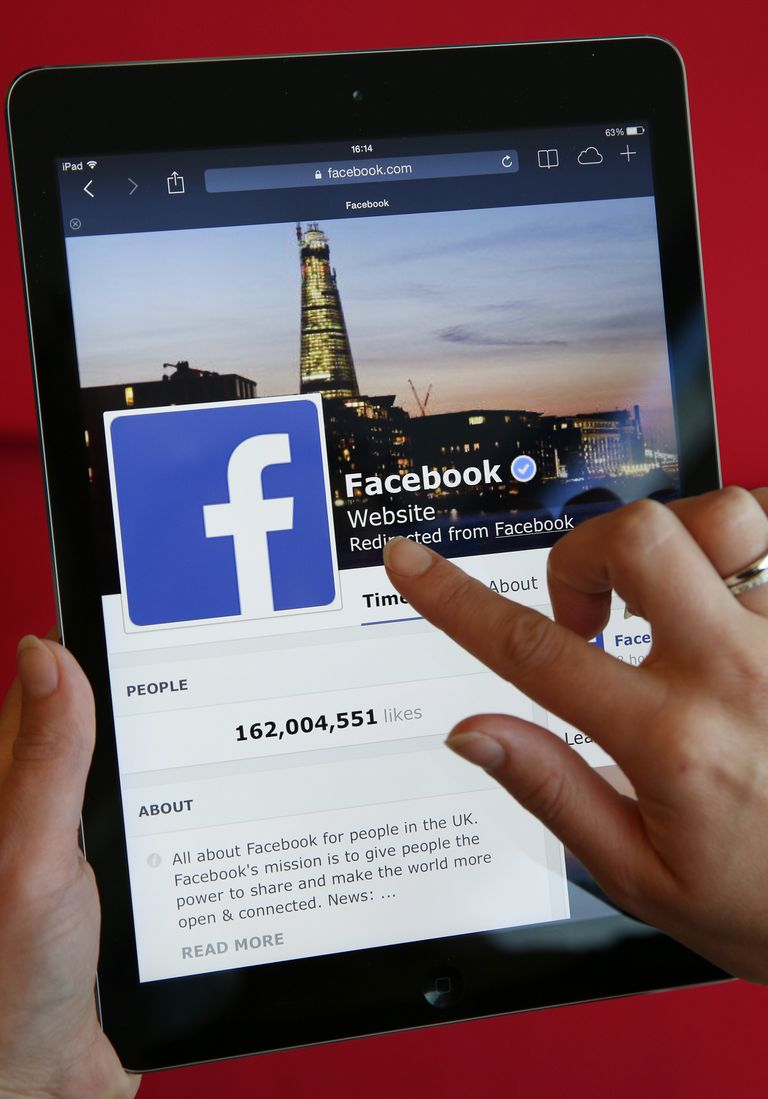 Image of a person using Facebook